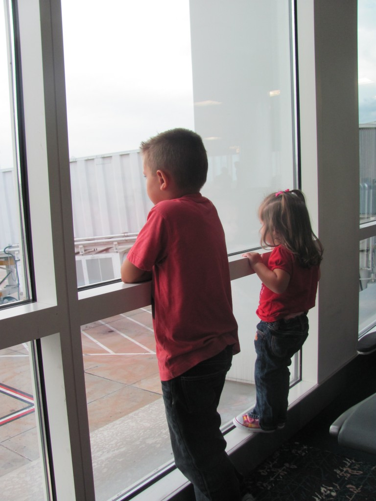 Watching and waiting for the JetBlue airplane to take them to the Bahamas.
